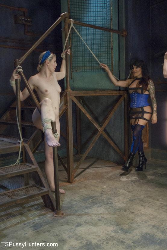 Kink TS 'Foxxy Takes Another - Turning Ella Nova into her cock Slut' starring TS Foxxy (Photo 1)