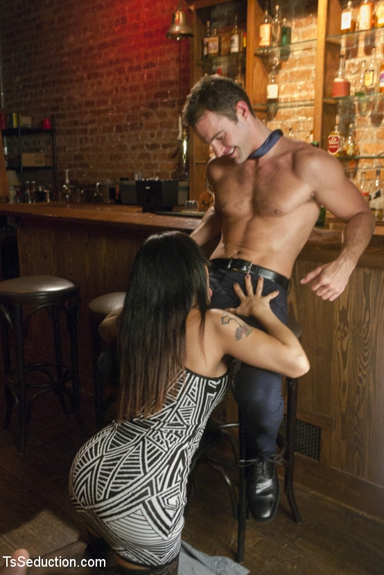 Kink TS 'Tell Mama - Bartender Seduces Sad Sack Patron with Her Hard Cock!!' starring TS Foxxy (Photo 2)